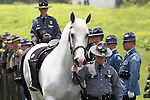 A rideless horse was preceded the caisson as Kentucky State Trooper Eric Keith Chrisman was laid to rest Monday June 29, 2015 in Lawrenceburg, Ky.  He died in the the line of duty June 23, 2015.  Police officers and Fire fighters from across Kentucky and the Nation came to pay respects to his family.  Photo by Mark Mahan