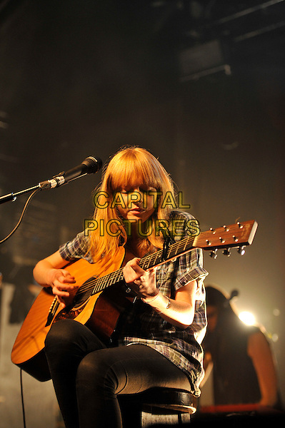 Lucy Rose performing live in concert, Heaven, London, England. .20th June 2012.ons stage in concert live gig performance music half length black sitting check shirt guitar grey gray white  .CAP/MAR.© Martin Harris/Capital Pictures.