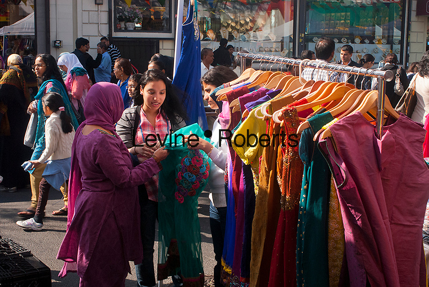Shoppers browse saris at a Diwali street fair in the Queens neighborhood of Jackson Heights in New York on Sunday, October 14, 2012. The Jackson Heights neighborhood is home to a mosaic of ethnic groups beside Indians which include Pakistanis, Tibetans, Southeast Asian as well as long-time Jewish, Irish and Italian residents.  (© Richard B. Levine)