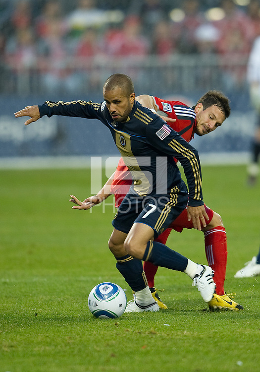 15 April 2010: Toronto FC midfielder Martin Saric #25 and Philadelphia Union midfielder Fred #7 battle for a ball during a game between the Philadelphia Union and Toronto FC at BMO Field in Toronto..Toronto FC won 2-1..Photo by Nick Turchiaro/isiphotos.com.