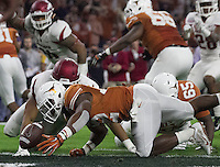 Arkansas Democrat-Gazette/BENJAMIN KRAIN --12/29/14--<br /> Texas quarterback Tyrone Swoopes fumbles in the endzone as the Razorback defense recovers for a touchdown during the 2nd quarter in the Texas Bowl Monday night at NRG Stadium in Houston.