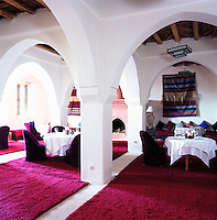 A network of white arches spans the indoor dining room