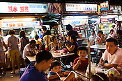 Locals gather to eat at a Chinese Hawker stall in Gurney Drive, Georgetown in Penang, Malaysia. Photo: Sanjit Das/Panos
