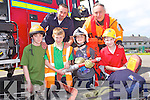 CIVIL DEFENCE: Member's of the Civil Defence with pupils of Scoil Mhic Easmainn, Tralee at the school on Friday front l-r: Ben O? Caomha?naigh, Tadhg O? Ceilleachair, Sea?mus De Ro?ista and Do?nal O? Briain. Back l-r: Paul McDonnell (Commander) and Gea?ro?id O? Caomha?naigh (transport officer).