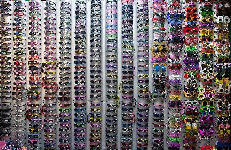 Sunglasses sale in the Yiwu Small Commodity Market, the world's largest wholesalers market selling more than 17 million kinds of commodities that are exported all over the globe. More than 200 metric tones of goods are exported from Yiwu every day.