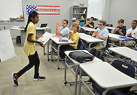 NWA Democrat-Gazette/MICHAEL WOODS &bull; @NWAMICHAELW<br /> Haas Hall Academy 7th graders clap after fellow student Deeksha Shanmuganathan (left) finishes a public speaking exercise during class Friday August 7, 2015, at the new Bentonville campus.  Classes at the new Bentonville campus started Thursday.