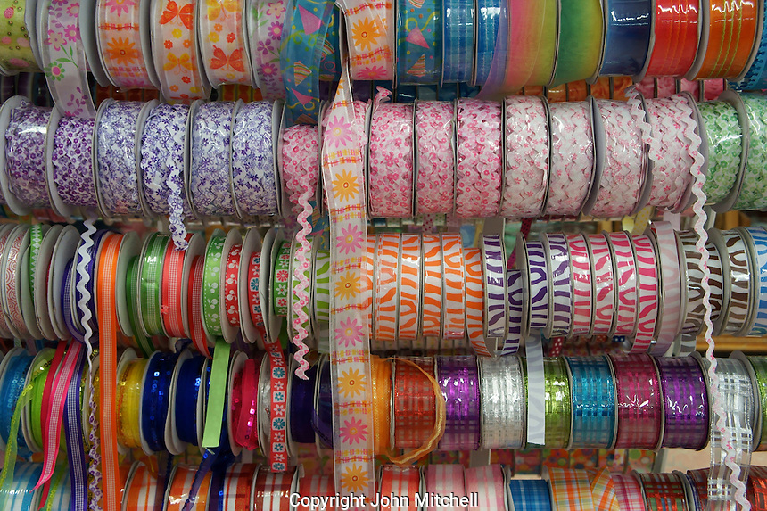 Spools of colorful ribbon in a fabric store, Merida, Yucatan, Mexico.