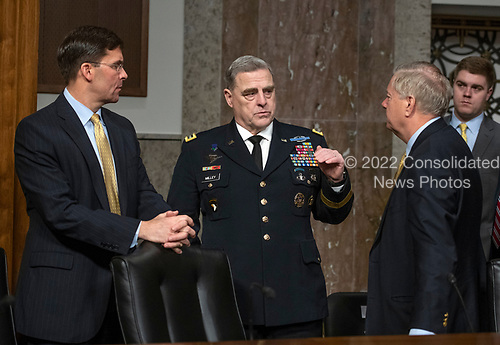 """Mark T. Esper, Secretary of The United States Army, left, US Army General Mark A. Milley, Chief of Staff of The Army, center, and US Senator Lindsey Graham (Republican of South Carolina) share conversation prior to the hearing before the US Senate Committee on Armed Services """"on the posture of the Department of the Army in review of the Defense Authorization Request for Fiscal Year 2019 and the Future Years Defense Program"""" on Capitol Hill in Washington, DC on Thursday, April 12, 2018.<br /> Credit: Ron Sachs / CNP"""