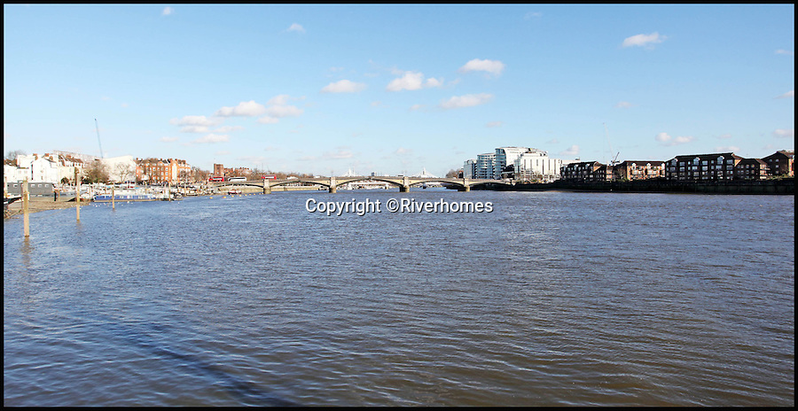 BNPS.co.uk (01202 558833)<br /> Pic: Riverhomes/BNPS<br /> <br /> Thames view over Chelsea.<br /> <br /> Heart of Lightness - Tardis like houseboat on the Thames.<br /> <br /> A houseboat that looks more like a luxurious penthouse suite inside has gone on the market for a whopping £1.5 million - because it's in one of London's most exclusive locations.<br /> <br /> The 100ft vessel was once a former Dutch barge taking supplies up and down the Thames until it was retired from service in the 1960s and left to rot.<br /> <br /> But a decade later it was salvaged and turned into a houseboat before undergoing a complete refurbishment four years ago and moved to a premier mooring alongside one the swankiest addresses in the city.<br /> <br /> The plush houseboat, berthed at the entrance to Cheyne Walk, now boasts a lavish living room, stylish 50ft-long kitchen, a spiral staircase, two opulent bedrooms, three bathrooms and even a sun terrace.<br /> <br /> And despite its eye-watering £1.5m asking price, experts at Riverhomes estate agents say the houseboat is actually a bargain and that anyone wanting to live in such luxury in the heart of Chelsea would have to shell out many millions more.