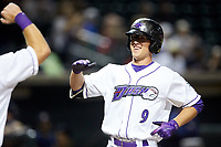 Blake Rutherford (9) of the Winston-Salem Dash is all smiles as he crosses home plate after hitting his first home run of the season against the Buies Creek Astros at BB&T Ballpark on May 5, 2018 in Winston-Salem, North Carolina. The Dash defeated the Astros 6-2. (Brian Westerholt/Four Seam Images)