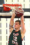 Lincoln Trail College player Jesse Tesmer (52) dunks the ball late in the first half against SWIC.