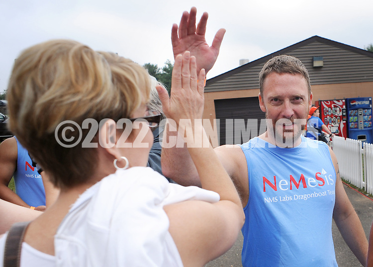 PDRAGON20P<br /> Donna Miller (left) congratulates Greg Coates of Team Nemesis during the first annual Bucks County Dragon Boat Festival on Lake Luxembourg at Core Creek Park Saturday September 19, 2015 in Langhorne, Pennsylvania.  The purpose of the event is to Paddle Out Hunger with proceeds benefitting Bucks County Housing Group. (William Thomas Cain/For The Inquirer)