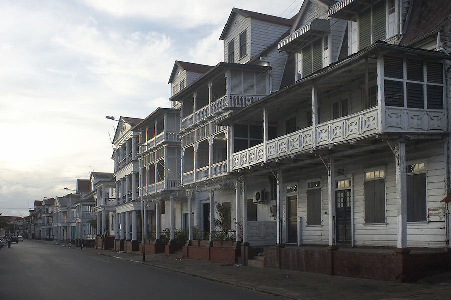 Street lined with old Colonial houses in the capital city of Paramaribo, Suriname.