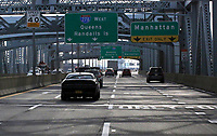 NEW YORK, NJ - DECEMBER 01: Cars move along the RFK  bridge on December 01, 2018 in New York City. According to the The National Climate Assessment draws on input from 13 federal agencies, climate change will slice hundreds of billions of dollars out of the US economy. By the end of the century, climate change could cost the United States $500 billion per year.(Photo by Kena Betancur/VIEWpress)