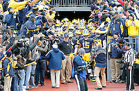 Michigan Wolverines head coach Jim Harbaugh leads his team onto the field prior to the NCAA football game against the Ohio State Buckeyes at Michigan Stadium in Ann Arbor on Nov. 28, 2015. Ohio State won 42-13. (Adam Cairns / The Columbus Dispatch)