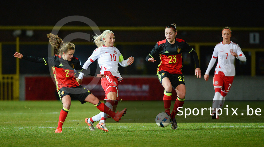 20161128 - TUBIZE ,  BELGIUM : Belgian Davina Philtjens (2) and Elien Van Wynendaele (23) with Danish Pernille Harder (10) and Sanne Troelsgaard (7) pictured during the female soccer game between the Belgian Red Flames and Denmark , a friendly game before the European Championship in The Netherlands 2017  , Monday 28 th November 2016 at Stade Leburton in Tubize , Belgium. PHOTO SPORTPIX.BE | DIRK VUYLSTEKE