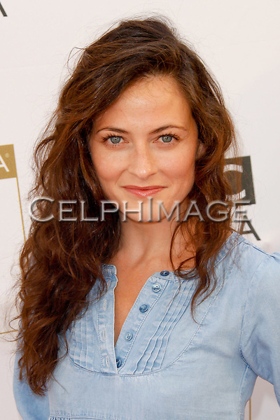 LARA PULVER. 8th Annual BAFTA/LA TV Tea Party at the Hyatt Regency Century Plaza. Los Angeles, CA, USA. August 28, 2010. ©Tim Copeland/CelphImage