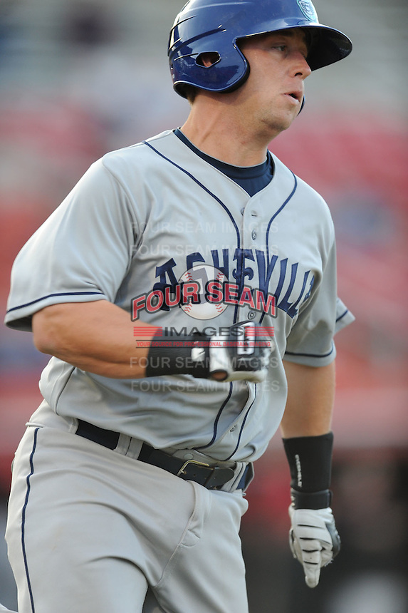 Asheville Tourists Bryce Massanari #25 runs to first a game vs. the Hickory Crawdads at L.P. Franz Stadium in Hickory,  North Carolina;  April 7, 2011.  Hickory defeated Asheville 4-2.  Photo By Tony Farlow/Four Seam Images
