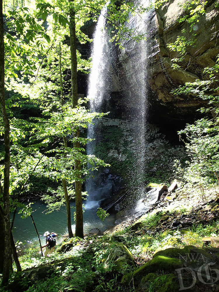 NWA Democrat-Gazette/ FLIP PUTTHOFF<br /> Gene Williams hikes to the base of Sweden Creek Falls in Madison County on Thursday May 14 2015. The 80-foot waterfall is at a horseshoe canyon in the Sweden Creek Natural Area.