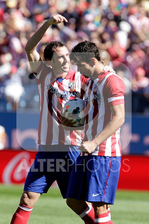 Atletico de Madrid´s Godin (L) and Diego Costa during La Liga 2013/14 match. October 06, 2013. (ALTERPHOTOS/Victor Blanco)