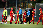 Players of China shake hands with referees after their ICC 2016 Women's World Cup Asia Qualifier match between China and Nepal on 11 October 2016 at the Kowloon Cricket Club in Hong Kong, China. Photo by Marcio Machado / Power Sport Images