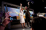 Republican presidential candidate Michele Bachmann and husband, Marcus, wave to the crowd at the Straw Poll in Ames, Iowa, August 13, 2011.