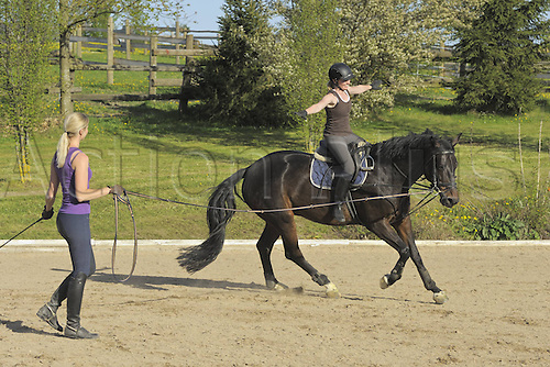 28.04.2012. Germany. Equestrian training as a young rider rides a horse without reigns. Model Released