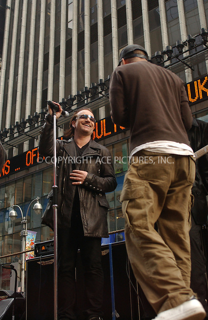 """WWW.ACEPIXS.COM . . . . . ....NEW YORK, NOVEMBER 22, 2003....Bono filming a promotional video for the new U2 album """"How to Dismantle an Atomic Bomb"""" in NYC.....Please byline: ACE006 - ACE PICTURES.. . . . . . ..Ace Pictures, Inc:  ..Alecsey Boldeskul (646) 267-6913 ..Philip Vaughan (646) 769-0430..e-mail: info@acepixs.com..web: http://www.acepixs.com"""