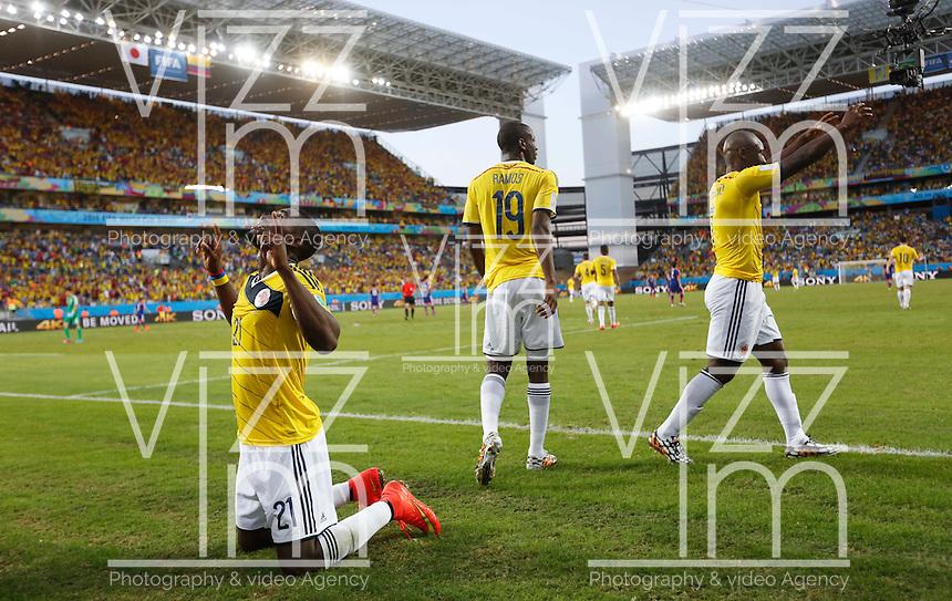 CUIABA - BRASIL -24-06-2014. Foto: Roberto Candia / Archivolatino<br /> Jackson Martinez (#21) jugador de Colombia (COL) celebra un gol anotado a Japón (JPN) durante partido del Grupo C de la Copa Mundial de la FIFA Brasil 2014 jugado en el estadio Arena Pantanal de Cuiaba./ Jackson Martinez (#21) player of Colombia (COL) celebrates a goal scored to Japan (JPN) during the match of the Group C of the 2014 FIFA World Cup Brazil played at Arena Pantanal stadium in Cuiaba. Photo: Roberto Candia / Archivolatino<br /> VizzorImage PROVIDES THE ACCESS TO THIS PHOTOGRAPH ONLY AS A PRESS AND EDITORIAL SERVICE IN COLOMBIA AND NOT IS THE OWNER OF COPYRIGHT; ANOTHER USE IS REPONSABILITY OF THE END USER. NO SALES, NO MERCHANDASING. ALL COPYRIGHT IS ARCHIVOLATINO