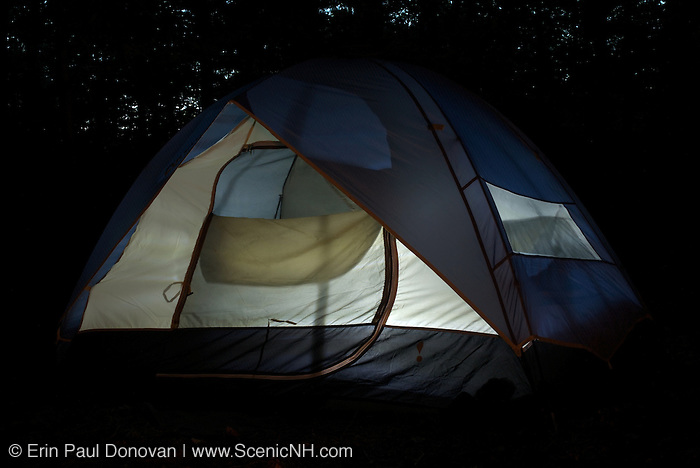 A light shines through a tents fabric during the night in a White Mountians, New Hampshire campground. USA