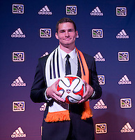 #16 overall pick A.J Cochran of the Houston Dynamo stands on the podium during the MLS SuperDraft at the Pennsylvania Convention Center in Philadelphia, PA, on January 16, 2014.