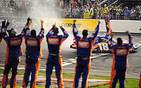 May 1, 2009; Richmond, VA, USA; NASCAR Nationwide Series driver Kyle Busch celebrates on track as he crew stand on the pit wall after winning the Lipton Tea 250 at the Richmond International Raceway. Mandatory Credit: Mark J. Rebilas-