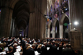 People stand as they attend the State Funeral for former President George H.W. Bush at the National Cathedral, Wednesday, Dec. 5, 2018, in Washington. <br /> Credit: Alex Brandon / Pool via CNP