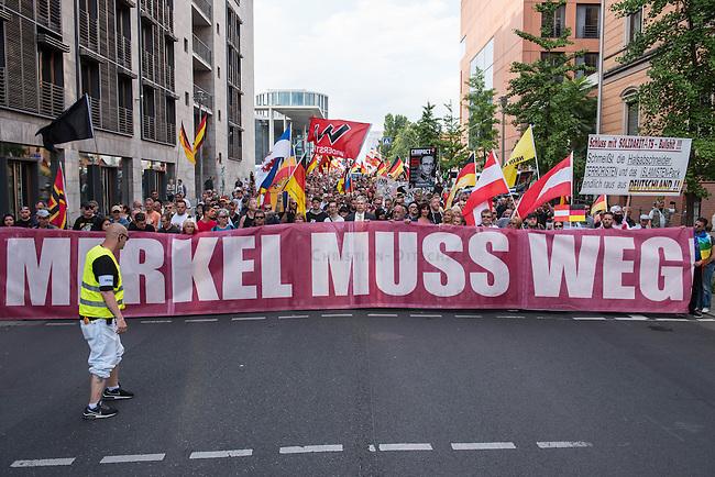 Neonazis und Hooligans demonstrieren gegen Angela Merkel.<br /> Unter dem Motto &quot;Merkel muss weg&quot; zogen ca. 1.200 am Samstag den 30. Juli 2016 mit einer Demonstration durch Berlin. Der Aufmarsch war vom einschlaegig bekannten Neonazi-Hooligan Enrico Stubbe angemeldet worden.<br /> Die Polizei hatte die Aufmarschroute der Rechten weitraeumig abgesperrt.<br /> Die Rechten forderten in Sprechchoeren immer wieder &quot;Nationalen Sozialismus! Jetzt!&quot; (ein strafrechtlicher Trick, gemeint ist der Nationalsozialismus), beschimpften waehrend ihres Aufmarsches permanent Gegendemonstranten &quot;Wir kriegen euch alle&quot; und &quot;Hurensoehne&quot; und die Medienvertreter &quot;Luegenpresse&quot;. Mitarbeiter der Sicherheitsbehoerden erklaerten, dass es eindeutig ein rechtsextremer Aufmarsch gewesen sei bei dem sich keinerlei buergerliche Teilnehmer beteiligt haetten. Der Berliner Chef des Landesamt fuer Verfassungsschutz war persoenlich vor Ort um sich einen Eindruck zu verschaffen.<br /> 30.7.2016, Berlin<br /> Copyright: Christian-Ditsch.de<br /> [Inhaltsveraendernde Manipulation des Fotos nur nach ausdruecklicher Genehmigung des Fotografen. Vereinbarungen ueber Abtretung von Persoenlichkeitsrechten/Model Release der abgebildeten Person/Personen liegen nicht vor. NO MODEL RELEASE! Nur fuer Redaktionelle Zwecke. Don't publish without copyright Christian-Ditsch.de, Veroeffentlichung nur mit Fotografennennung, sowie gegen Honorar, MwSt. und Beleg. Konto: I N G - D i B a, IBAN DE58500105175400192269, BIC INGDDEFFXXX, Kontakt: post@christian-ditsch.de<br /> Bei der Bearbeitung der Dateiinformationen darf die Urheberkennzeichnung in den EXIF- und  IPTC-Daten nicht entfernt werden, diese sind in digitalen Medien nach &sect;95c UrhG rechtlich geschuetzt. Der Urhebervermerk wird gemaess &sect;13 UrhG verlangt.]