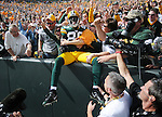 Green Bay Packers' Donald Driver leaps to the stands after his second half touchdown catch against the Buffalo Bills during the home opener at Lambeau Field in Green Bay, Wis., on Sunday, Sept. 19, 2010.