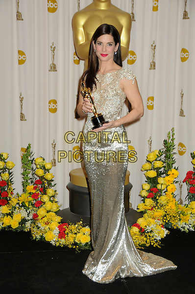 SANDRA BULLOCK.82nd Annual Academy Awards held at the Kodak Theatre, Hollywood, California, USA..March 7th, 2010.oscars full length silver gold beige silk satin maxi dress winner trophy.CAP/ADM/BP.©Byron Purvis/AdMedia/Capital Pictures.