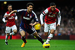 Ryan Shotton of Stoke City vies for the ball with Alex Oxlade Chamberlain of Arsenal during the  English Premier League soccer match between Arsenal and Stoke City in London,UK,02 February  2012.THOMAS CAMPEAN/Pixel8000 Ltd...