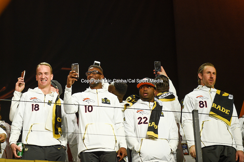 Monday, February 1, 2016: Denver Broncos quarterback Peyton Manning (18), wide receiver Emmanuel Sanders (10), running back C.J. Anderson (22) and tight end Owen Daniels (81), are introduced to fans during the opening day of  press conferences for the National Football League Super Bowl 50 between the Denver Broncos and the Carolina Panthers at the SAP Center, in San Jose, California. Eric Canha/CSM