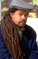 Man age 35 with dreadlocks looking curious. Exchange Charities Youth Festival Minneapolis  Minnesota USA