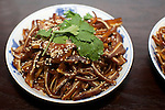 NEW YORK CITY, NY - SEPTEMBER 8, 2014: Shredded Pig Ears in Sesame-Chili Sauce at Tribeca's China Blue. The restaurant hosted dinner of traditional Chinese dishes that are less familiar to Western audiences for friends and adventurous eaters.<br /> <br /> <br /> &copy; Clay Williams / http://claywilliamsphoto.com