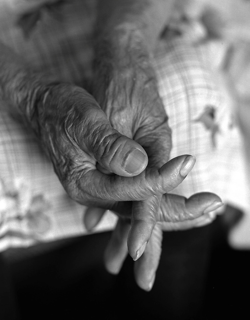 Hands of old farmworker.  Hispanic