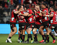 The Crusaders celebrate during the Super Rugby match between the Crusaders and Highlanders at Wyatt Crockett Stadium in Christchurch, New Zealand on Friday, 06 July 2018. Photo: Martin Hunter / lintottphoto.co.nz