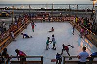 HAVANA, CUBA - JUNE 16: Cuban children skate on an artificial ice rink and art installation, called La Esquina Fria, The Cold Corner, by US artist Duke Riley, on Havana's waterfront Malecon, June 16, 2015 in Havana, Cuba. <br /> Daniel Berehulak for Panasonic/Lumix