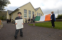 IFEATS: Kevin Walsh (4) the youngest pupil holds the proclamation while Samantha Riordan, (12) the oldest  holds the Tricolour with principal Evelyn O'Shea at Curraheen National School, Glenbeigh, County Kerry. <br /> Photo: Don MacMonagle <br /> <br /> ie1916