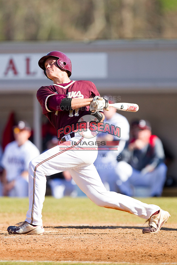 Jimmy Holton #11 of the College of Charleston Cougars follows through on his swing against the Davidson Wildcats at Wilson Field on March 12, 2011 in Davidson, North Carolina.  The Wildcats defeated the Cougars 8-3.  Photo by Brian Westerholt / Four Seam Images