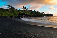 Black sand beach at Waianapanapa in Hana on Maui in the Hawaiian Islands