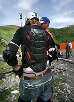 Most riders have crashed hard before and choose to wear a variety of protection, in this case a back plate. The first ever Norwegian Longboarding Championship was held during the Extreme Sport Week, an annual event that draws adrenalin junkies to the small Norwegian mountain town of Voss. © Fredrik Naumann