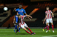 Stoke City's u23 Lewis Banks gets kneed on his head as he clears the ball from Rochdale's Jordan Slew<br /> <br /> Photographer Juel Miah/CameraSport<br /> <br /> EFL Checkatrade Trophy - Northern Section Group C - Rochdale v Stoke City U23s - Tuesday 3rd October 2017 - Spotland Stadium - Rochdale<br />  <br /> World Copyright &copy; 2018 CameraSport. All rights reserved. 43 Linden Ave. Countesthorpe. Leicester. England. LE8 5PG - Tel: +44 (0) 116 277 4147 - admin@camerasport.com - www.camerasport.com