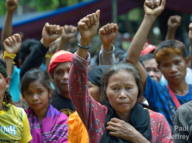 Indigenous people raise clenched fists during a demonstration in Koronadal City, on the southern Philippine island of Mindanao. Many of the indigenous are displaced, having been chased out of their rural villages by paramilitary squads.