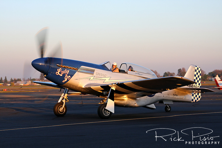 "Clarence ""Bud"" Anderson taxies the TF-51D Mustang ""Lady Jo"" after completing a flight during a gathering hosted by Dream Machines Inc. at Sacramento Executive Airport on January 30, 2009. Anderson was born on January 13, 1922 in Oakland, California, and earned his wings and commission as a second lieutenant in September 1942. During WWII Bud became a Triple Ace credited with 16 1/4 victories while flying with the 357th Fighter Group in the European Theatre."